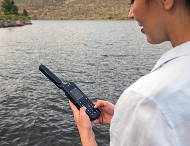 IsatPhone 2 in use by river